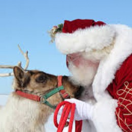 Santa giving reindeer kisses