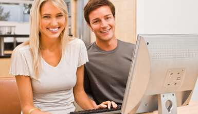 Image of couple on computer